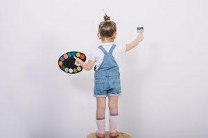 little girl artist holding palette brush crop